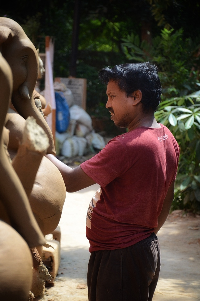 Putting in the finishing touches - Durga Puja