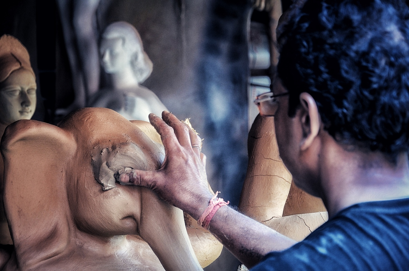 Durga Puja idol making by artisan from Bengal