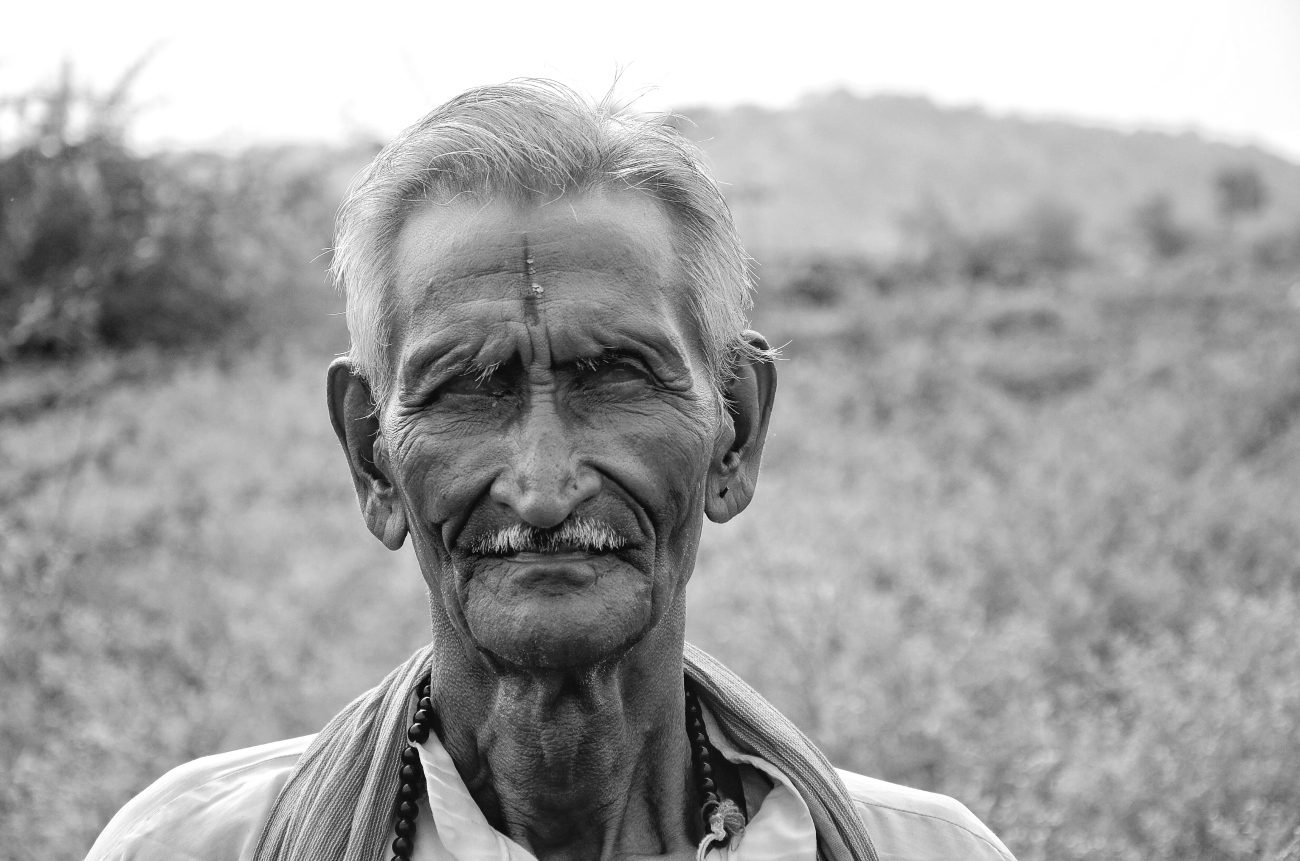 black and white photo of an old man