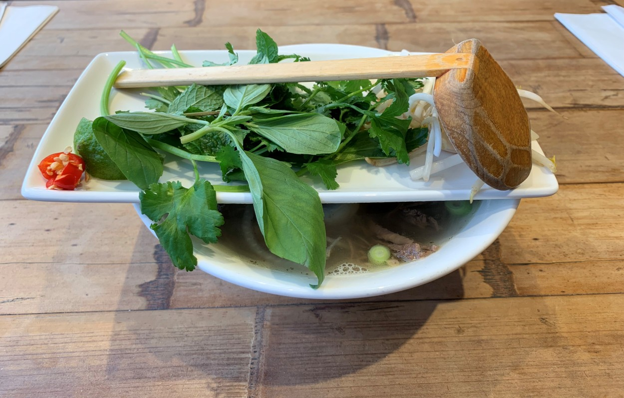 Herbs on top of a pho