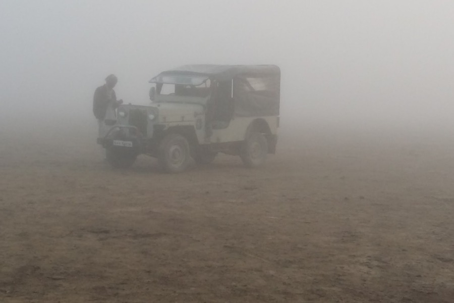 Jeep in the mist at Charri Dhand